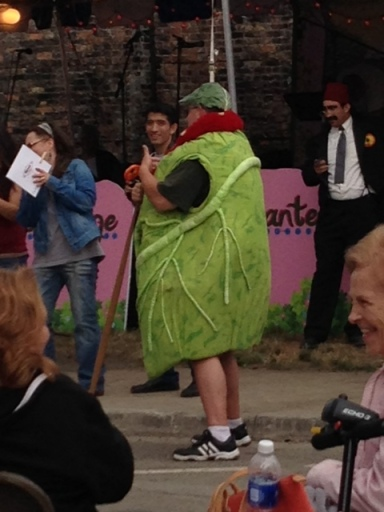 Man in a Stuffed Cabbage Roll costume.
