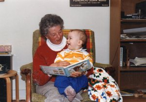 Reading this book made me go back and look at one of our old photo albums. This is my mother reading to Danny late in 1987.