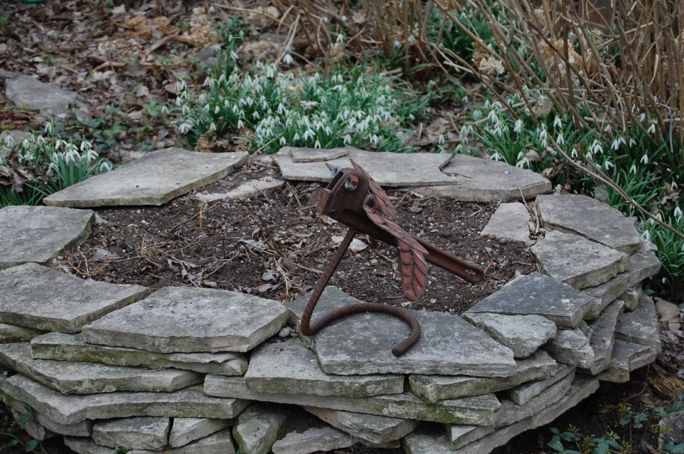 Dragonfly/wrench with snowdrops.