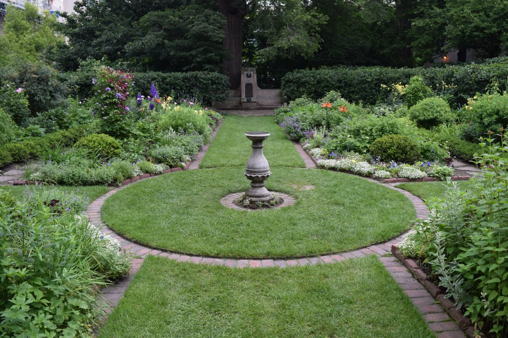 Sundial at the center of the four rectangular beds
