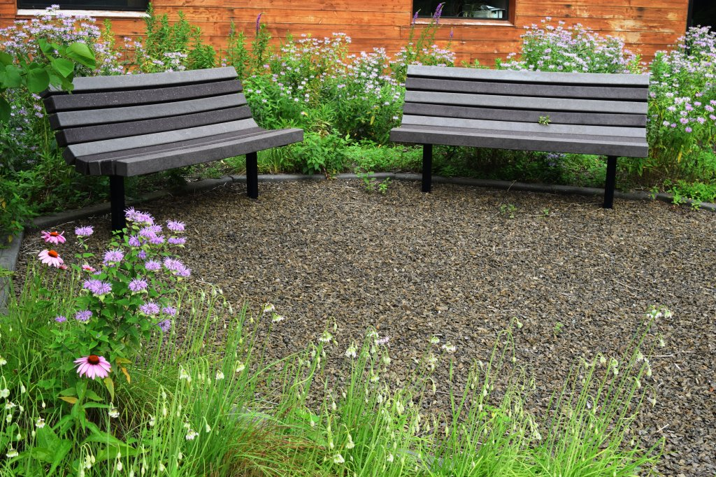 Two benches near the center of the garden.