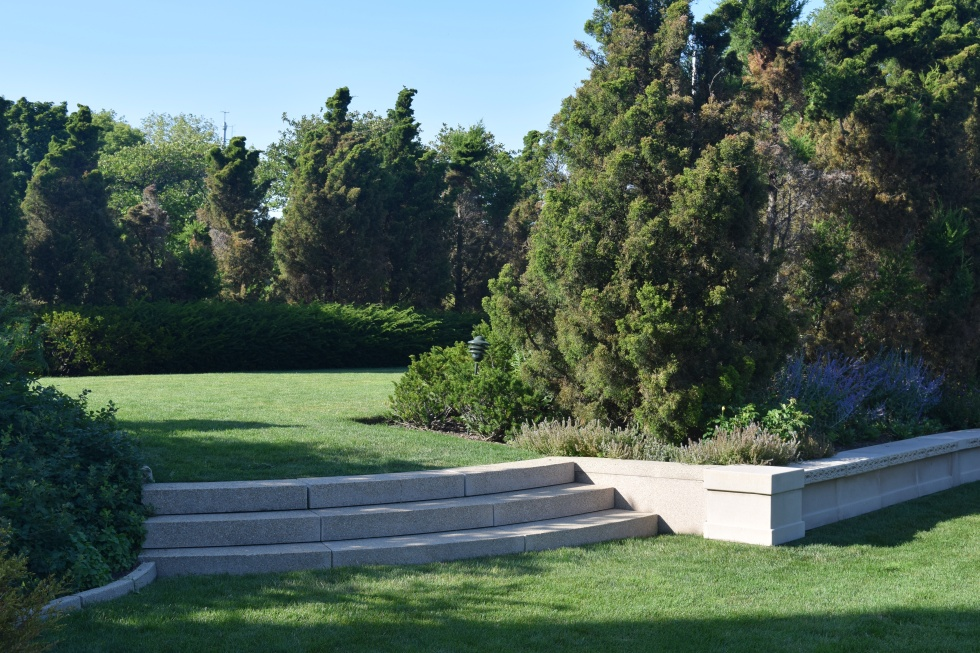 Gardens are at a lower elevation, the ground separating them is higher.