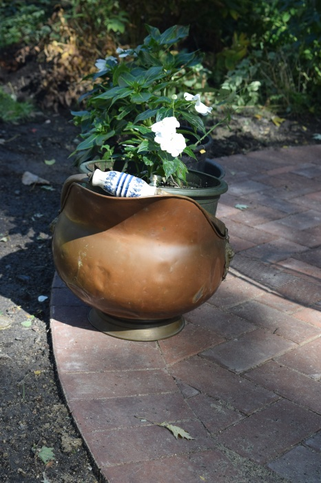Incidentally, this is an old coal scuttle we found in Wisconsin. I'm using it as a planter by putting a grower's conainer inside.