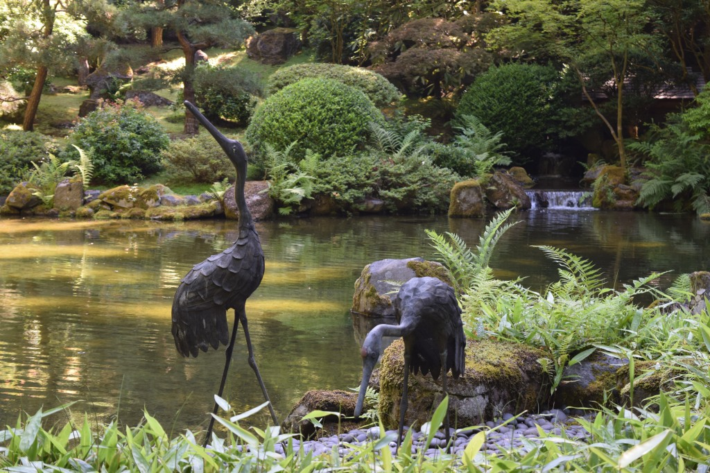 The upper pond of the Strolling Pond Garden. I wanted to steal these bird  (heron?) statues.
