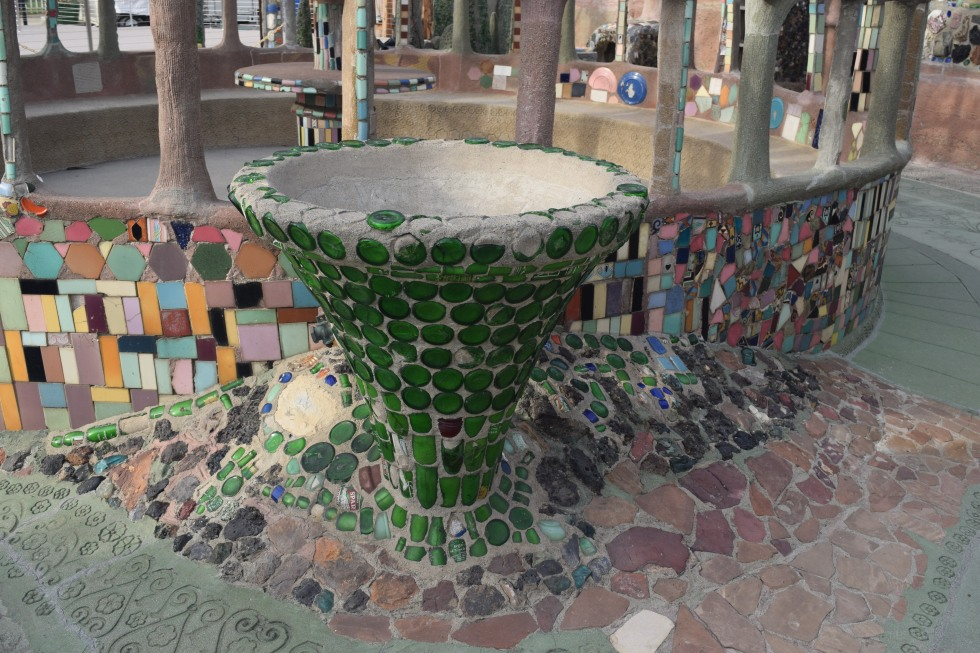 A baptismal font decorated with broken bottles. Rodia eventually became a Pentecostal minister.