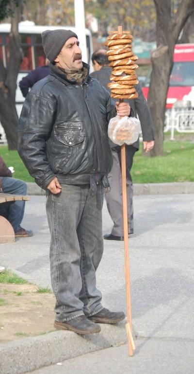Man selling simmits, a sort of Turkish bagel.