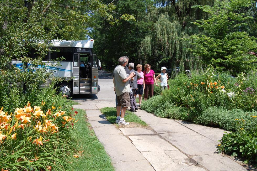 The 2012 Wild Ones garden tour arrives at Garden in a City.