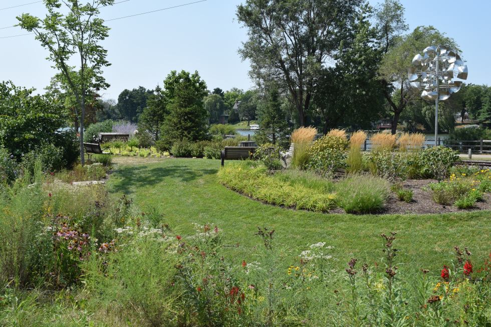 A Monarch Waystation is planted between the parking lot and the Rock River.