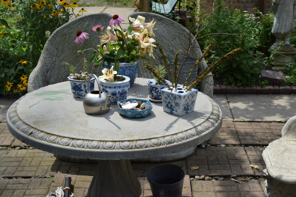 A small table with a variety of decorative pots.