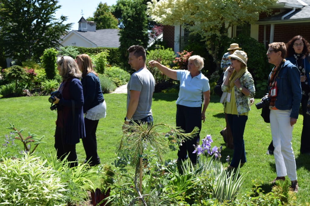 Marion Jarvie shows the garden bloggers some choice plants in her back garden.